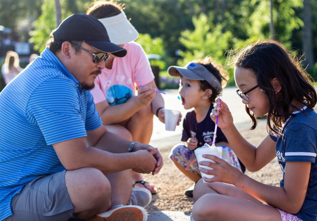 Kids enjoying a frozen treat at the River Prairie Park