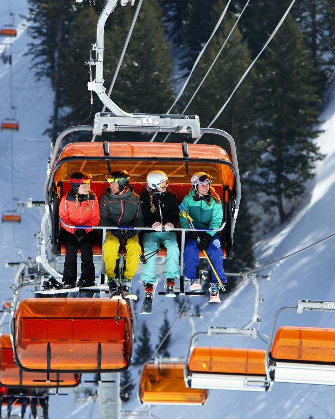 Group of skiers on Orange Bubble Lift
