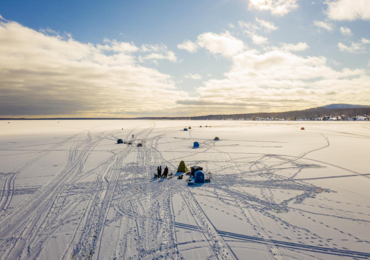 A drone image of people ice fishing in Big Bay, MI
