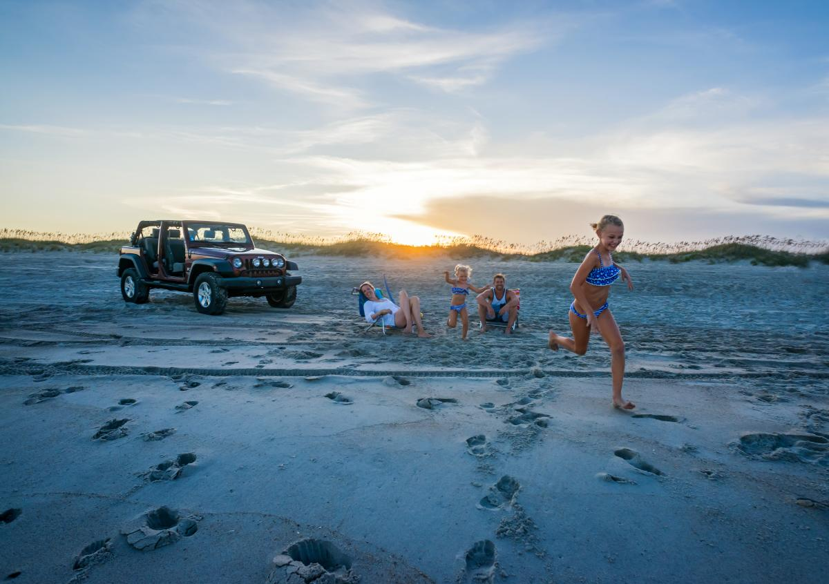 Jeep and family on beach at Fort Fisher State Recreation Area