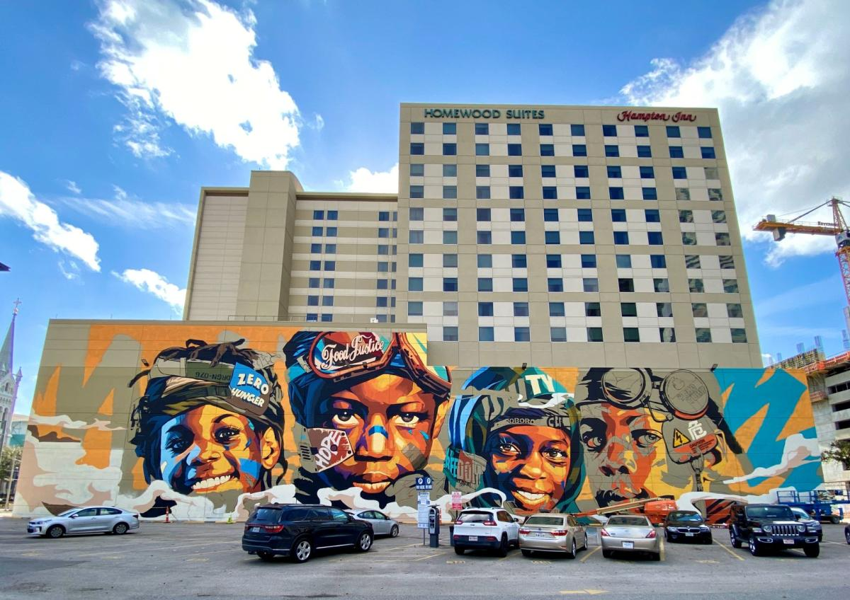 Mural of childrens' faces in honor of UN Zero Hunger Program