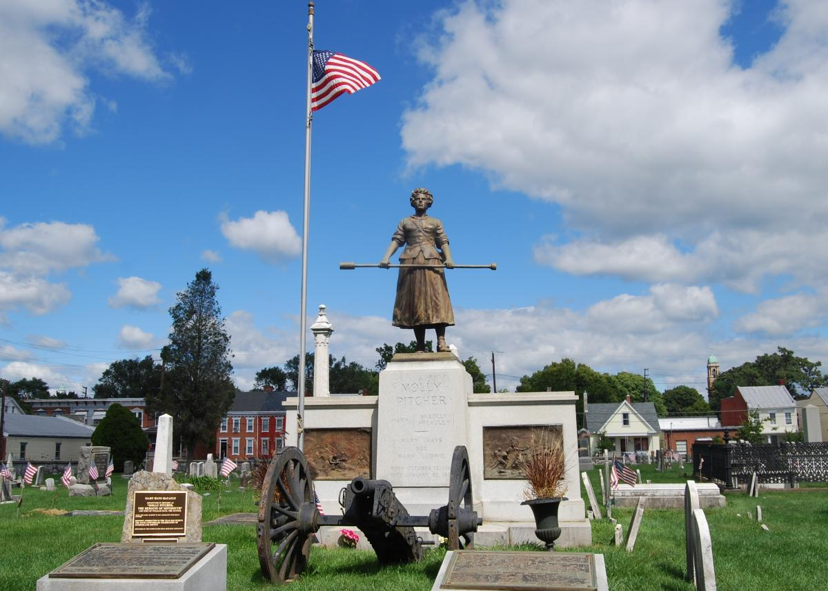 Molly Pitcher Statue With American Flag In The Cumberland Valley