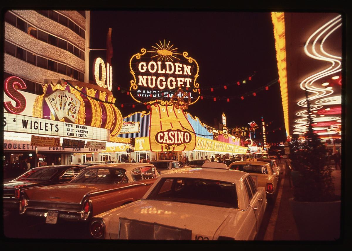 A vintage scene of cars and casinos along the Las Vegas Strip.