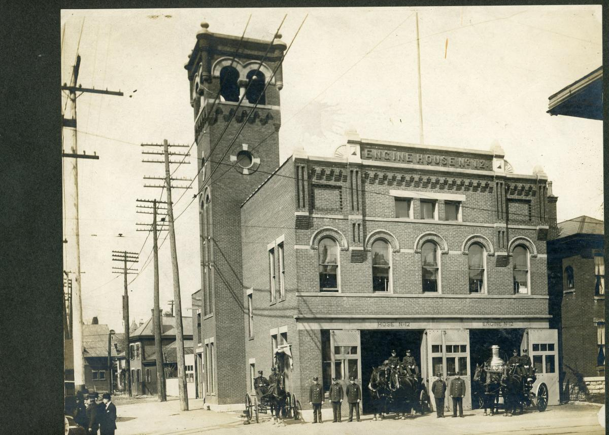 Firehouse #12 brigade poses outside of building that now houses Gemut Beirgarten