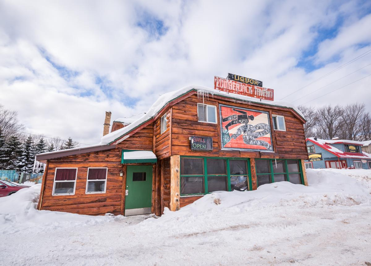 The snowy exterior of the notorious Lumber Jack Tavern in Big Bay, MI