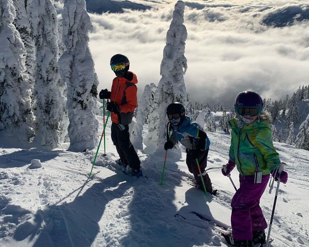 3 kids skiing at The Summit at Snoqualmie