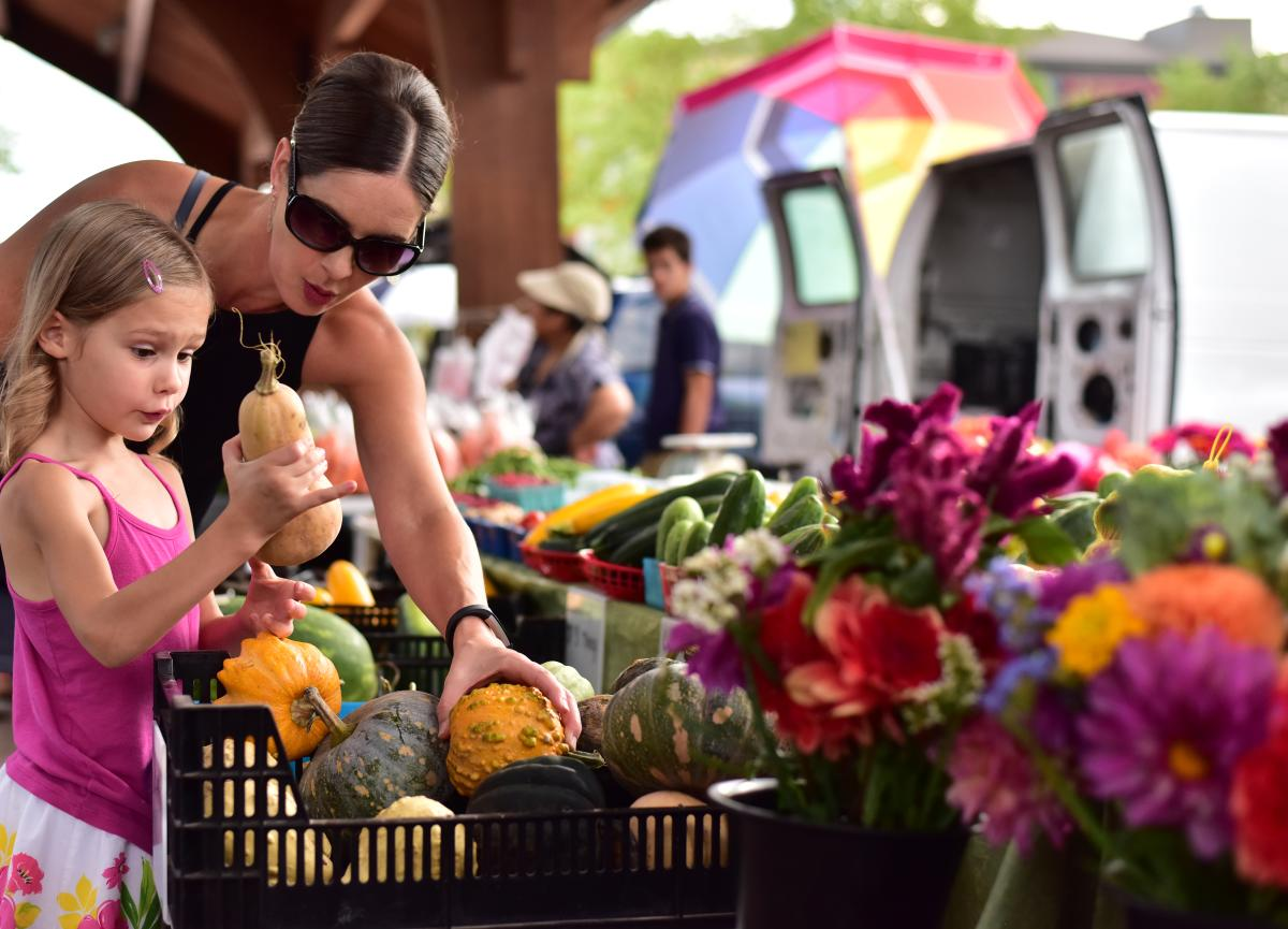 Family shopping at the Farmers Market in Downtown Eau Claire
