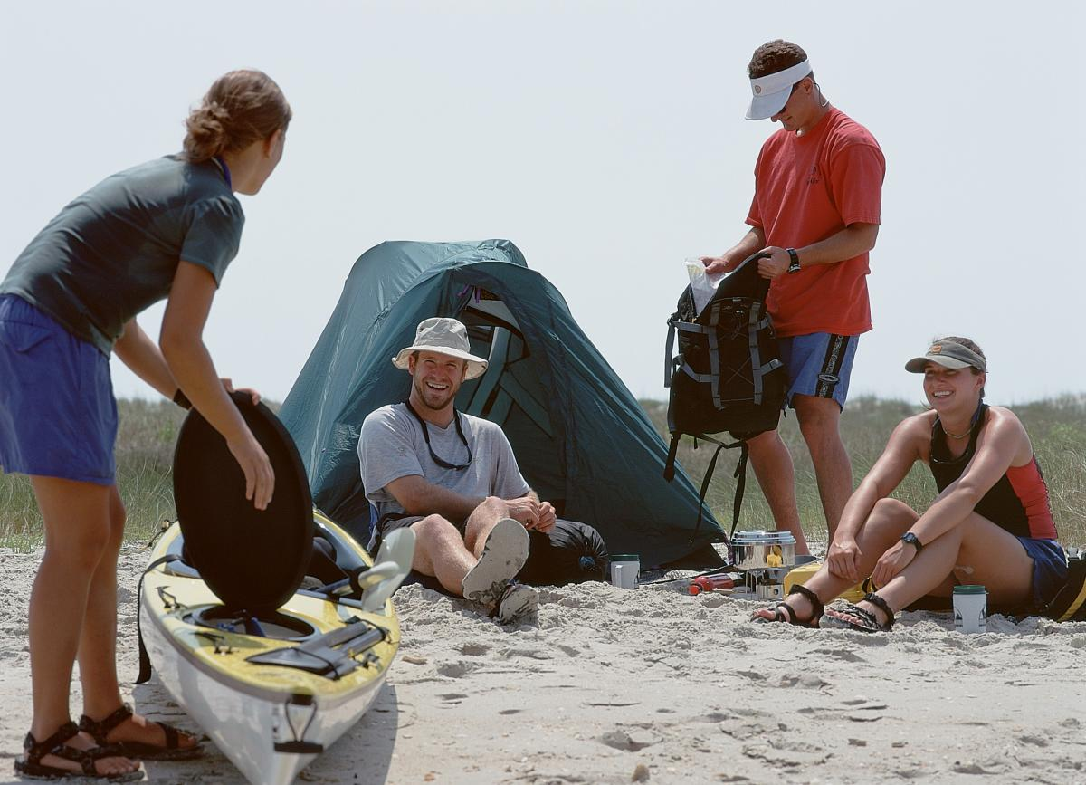 Couples camping on beach