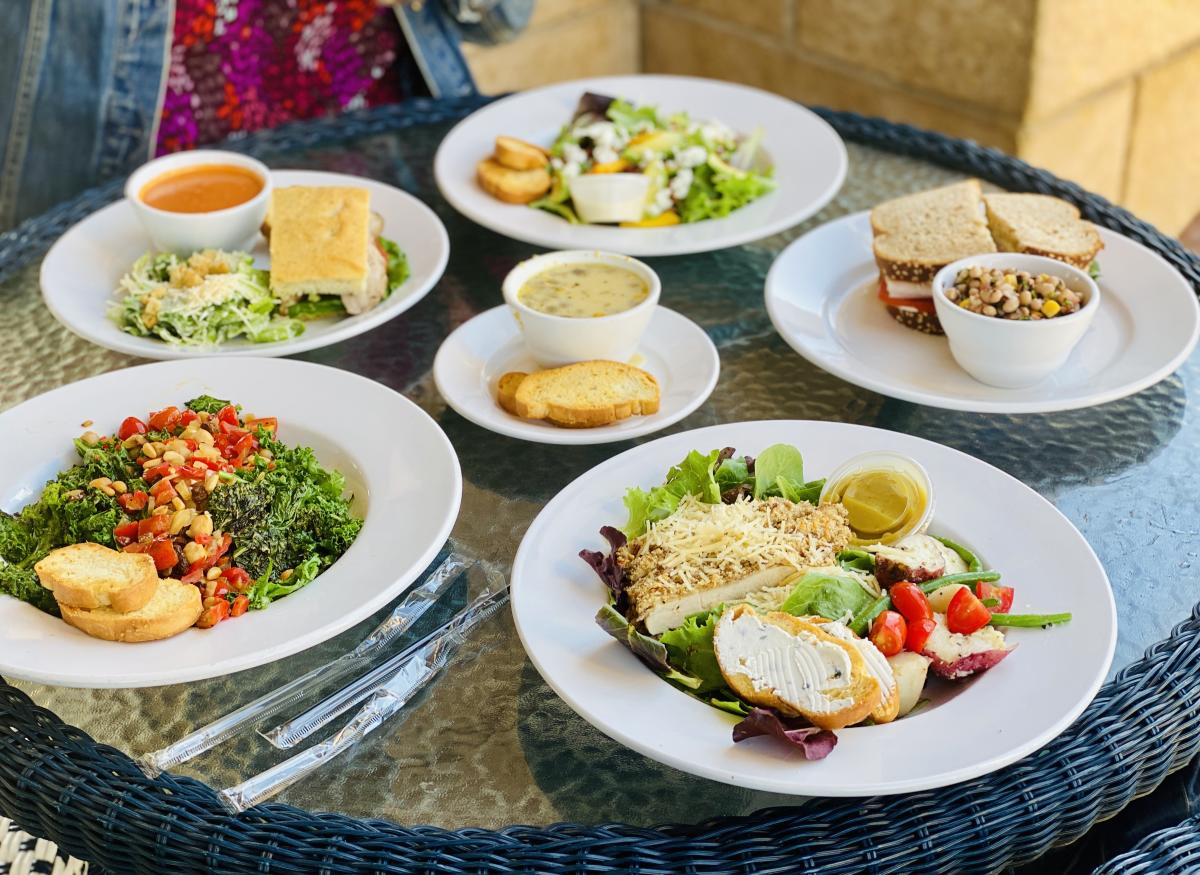 A patio lunch featuring a plate of Katherine's Pecan-Parmesan Crusted Chicken Salad.