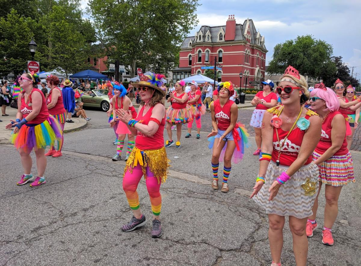 A women's dance group dressed in Pride colors at NKY Pride in Mainstrasse Village