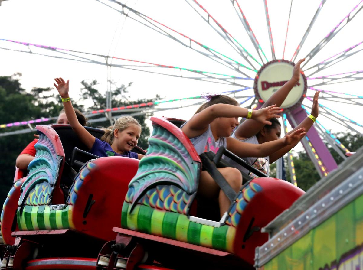 Midway rides with kids at Prince William County Fair