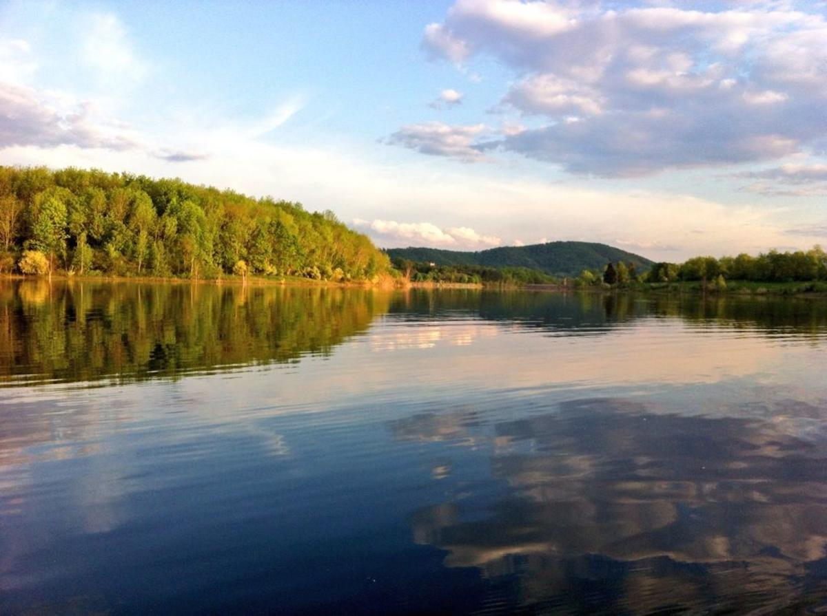 The colors of a sunset reflected on Leaser Lake In Lehigh Valley, PA