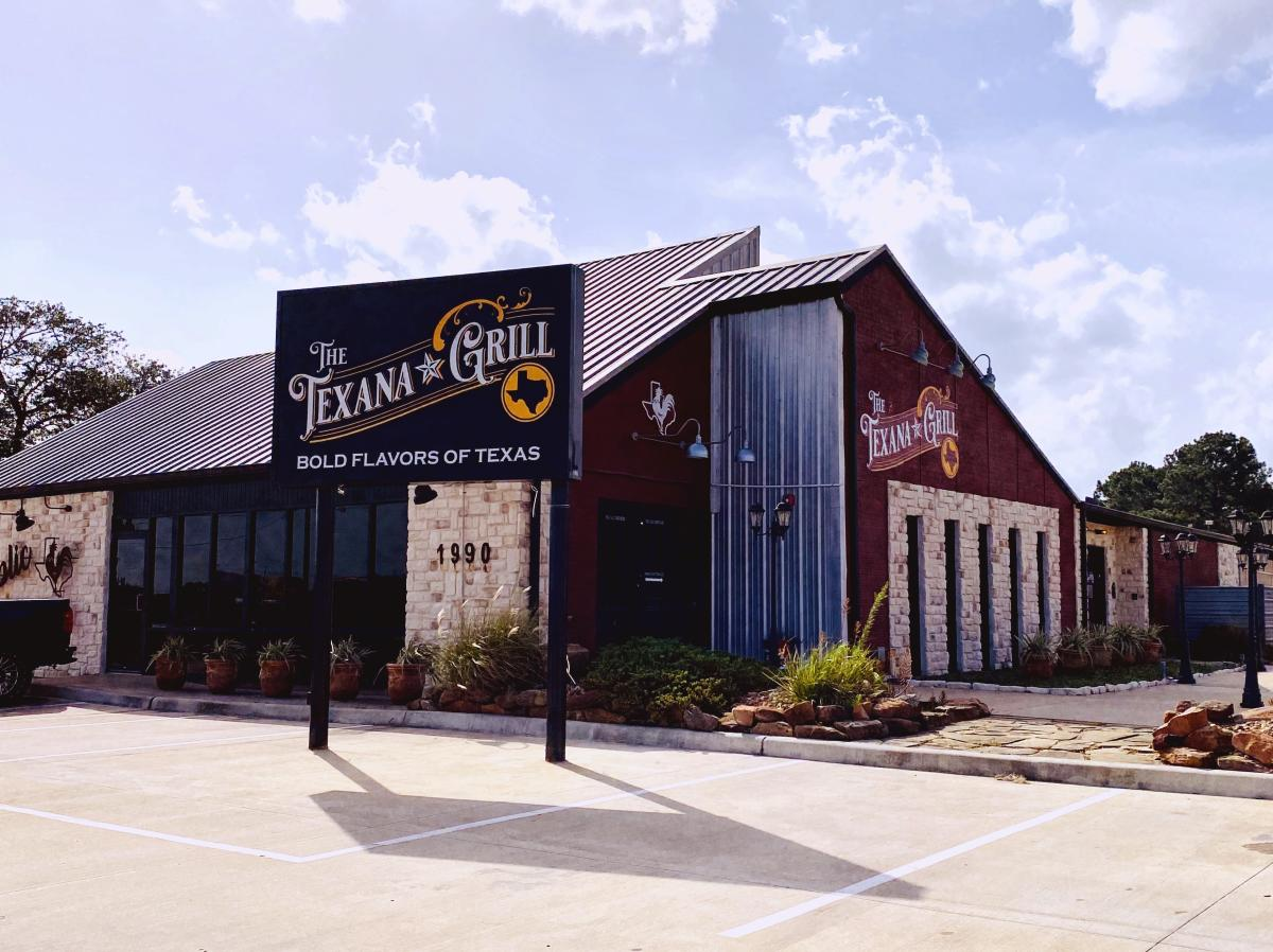 The Texana Grill building is made of red brick and Austin stone trim.