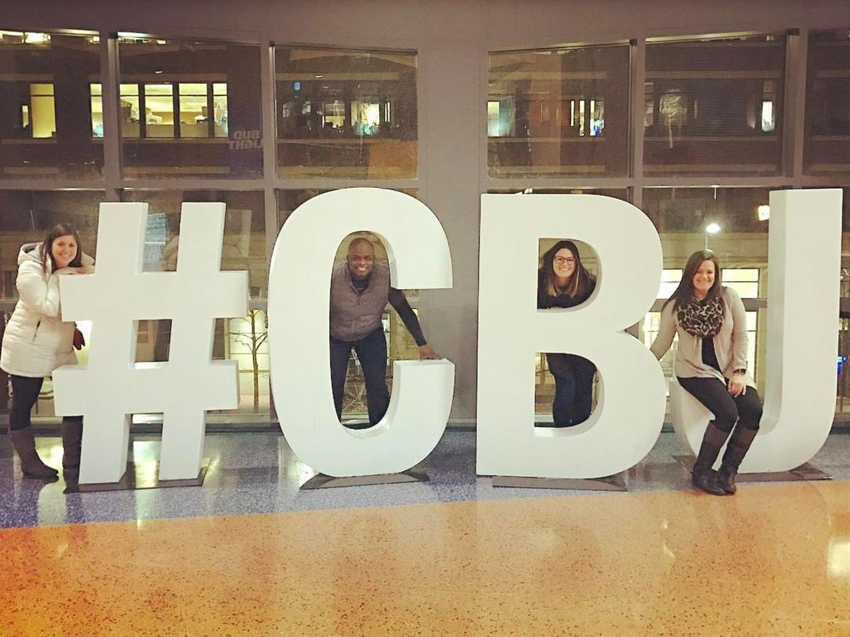 CBJ fans pose with giant letters