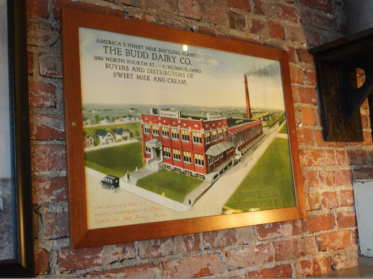 Old post card hanging at Budd Dairy Food Hall showing the space used to be an assembly hall
