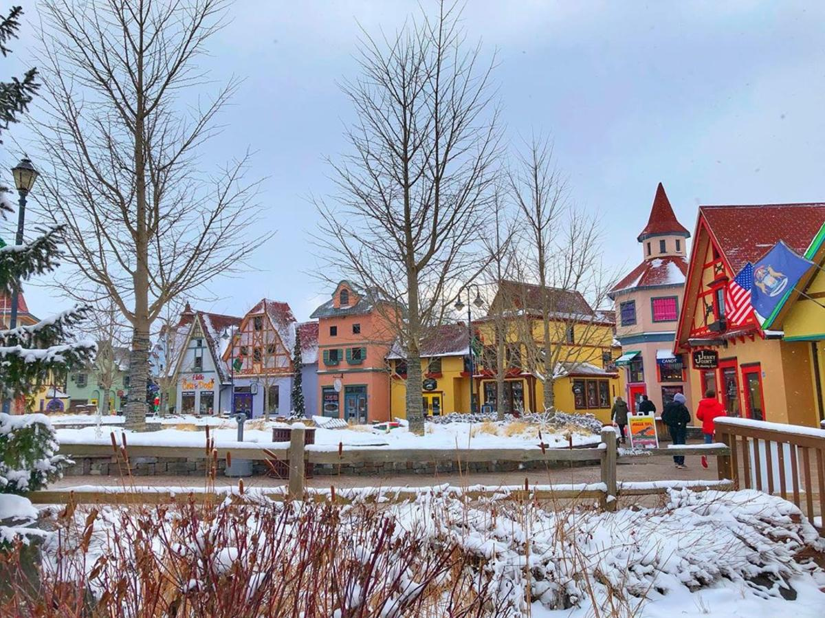 Colorful, snow-dusted storefronts at Frankenmuth River Place Shops