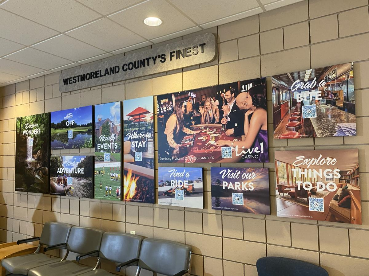 Handy Resource Wall with scannable QR codes at Arnold Palmer Regional Airport