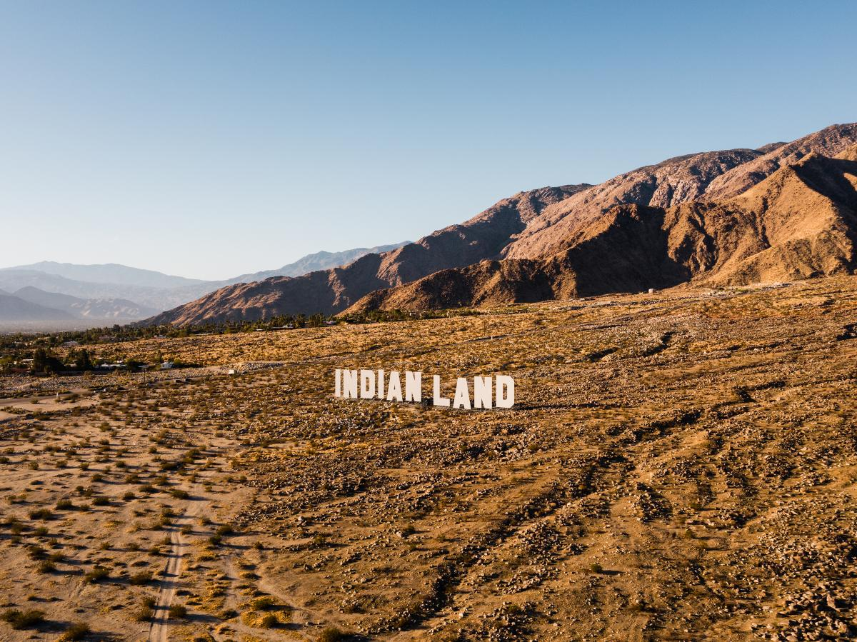 Indian Land letters in the desert with mountains