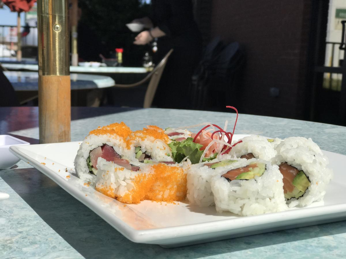 plate of sushi on an outdoor table