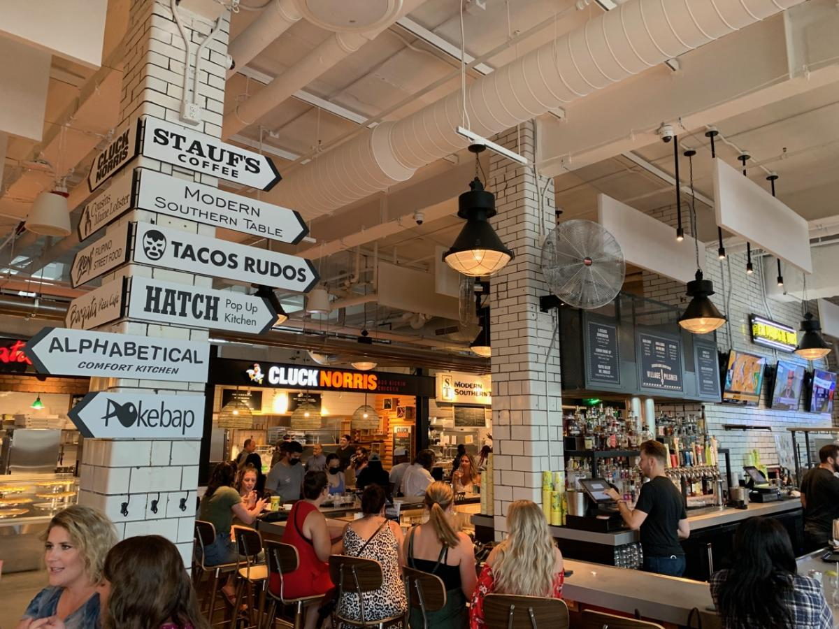 Signs lead the way for various restaurants inside Budd Dairy Food Hall