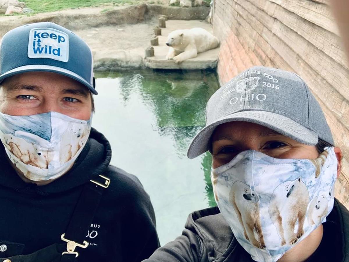 Columbus Zoo Employees posing with polar bear wearing masks