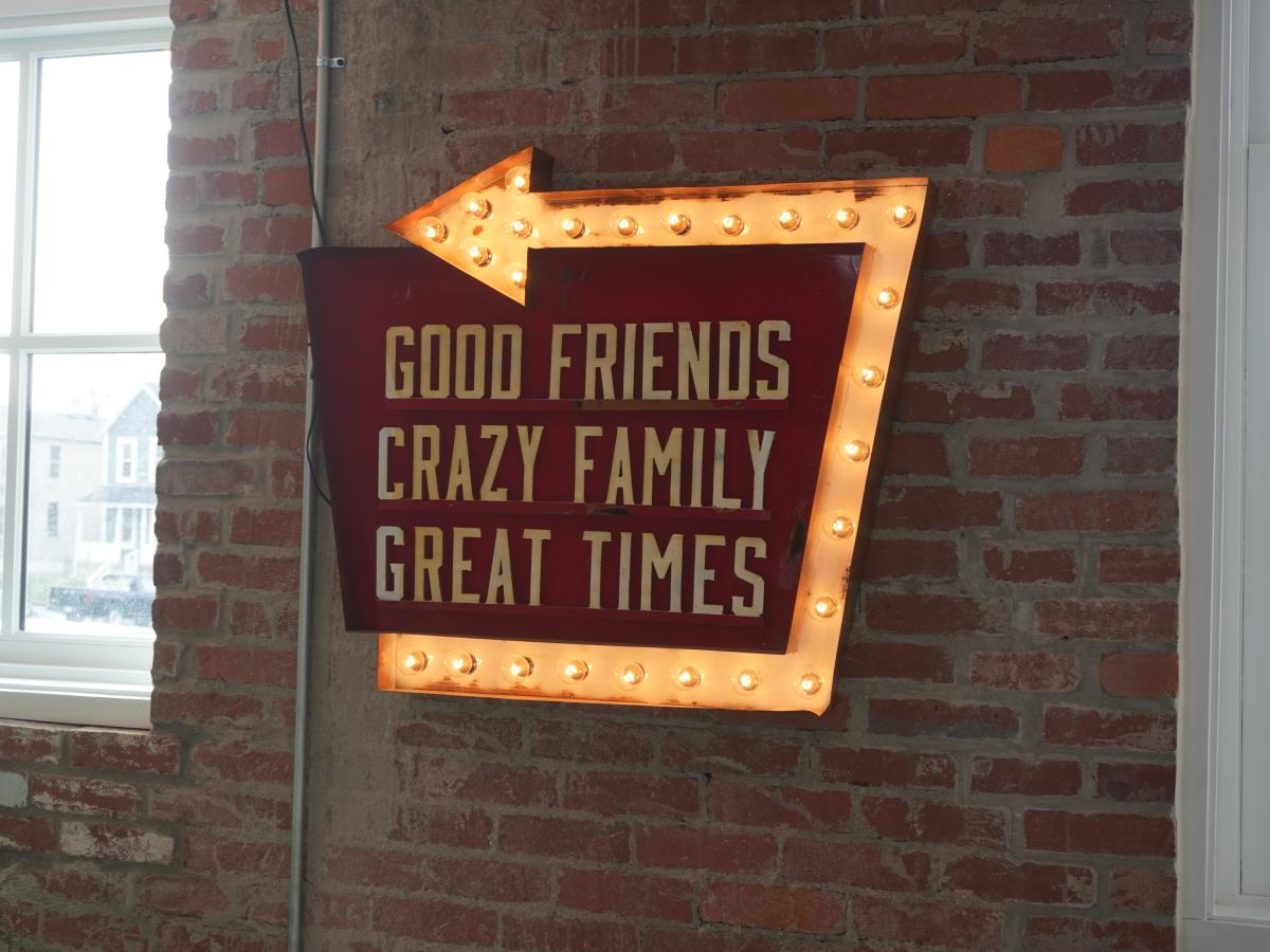 Budd Dairy sign directing to good friends, crazy family, great times