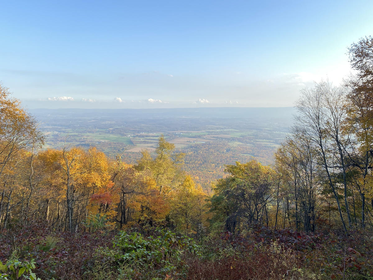 Top view of the Three Hollow Square Overlook looking down at the valley in the fall