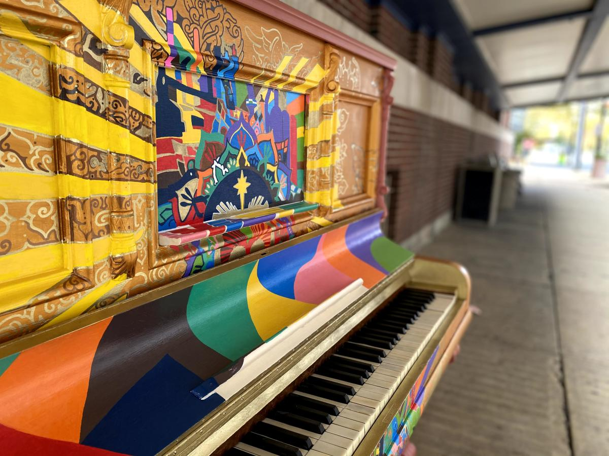 Love (Public Paino), a vibrant and colorful upright piano with many abstract shapes and patterns.