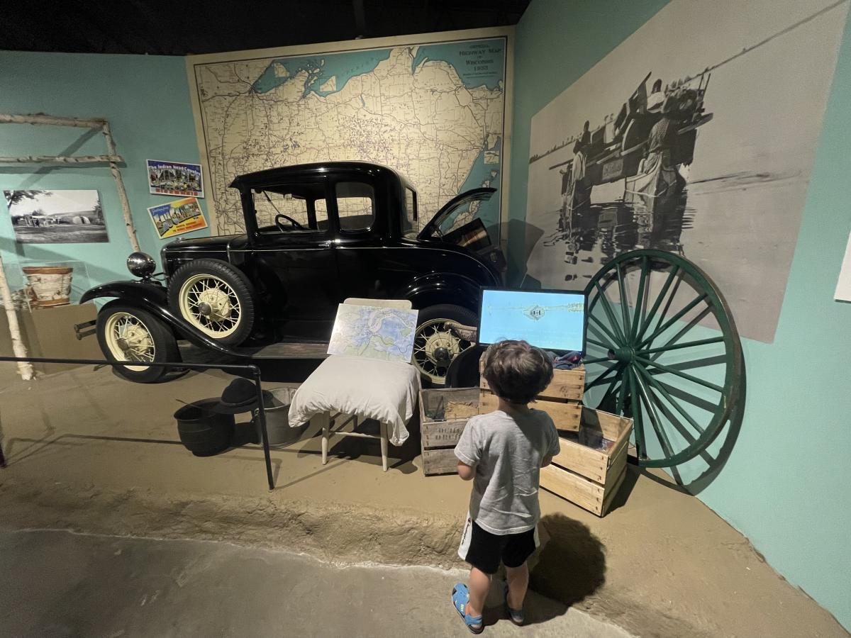 A little boy looking at an exhibit at the Chippewa Valley Museum