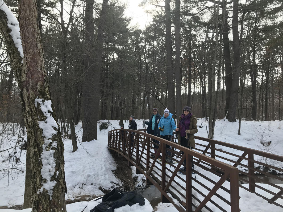Group snowshoeing at Town of Union Conservancy