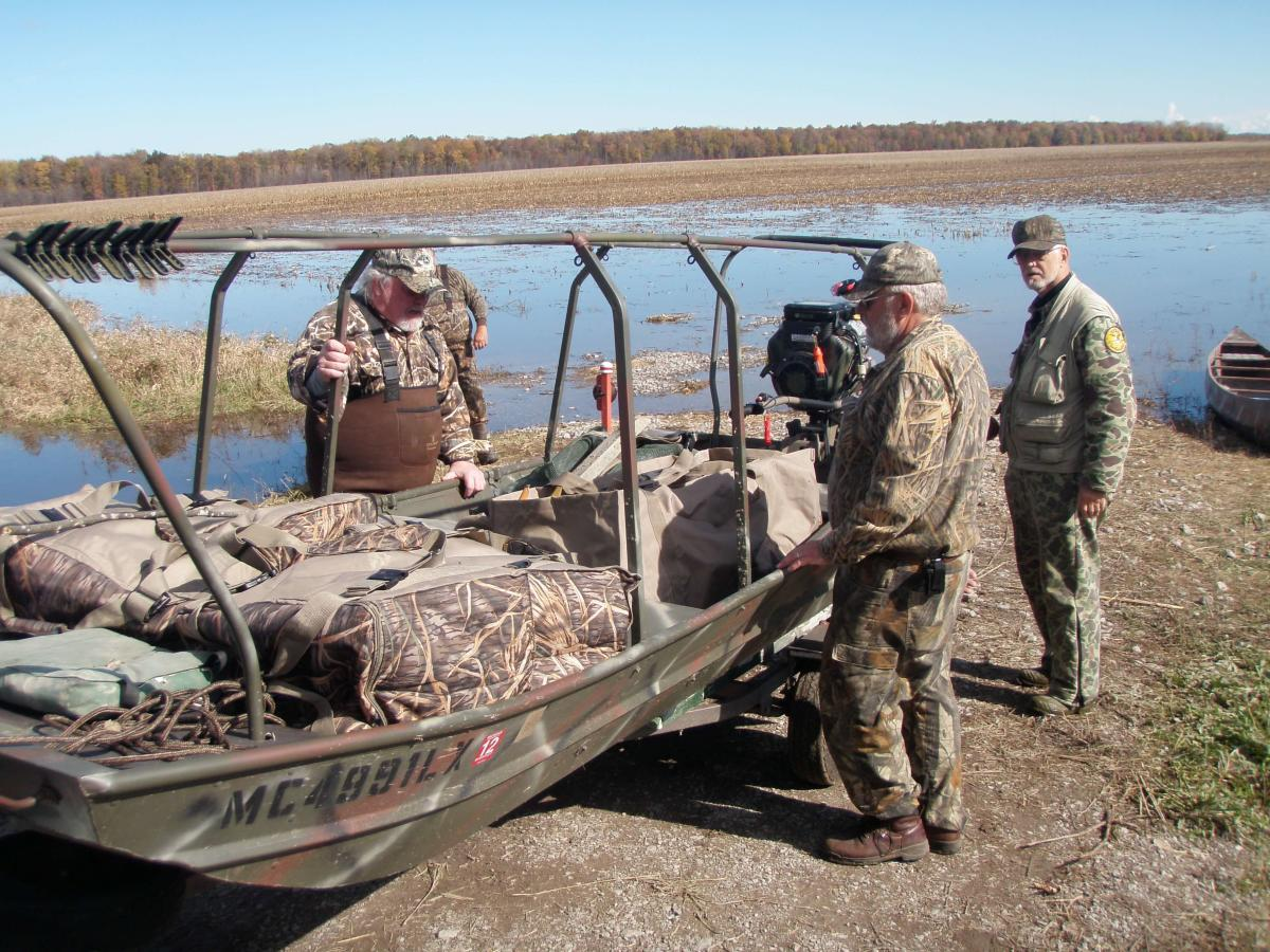 Duck hunters Launching their boat blind at Shiawassee River State Game Area