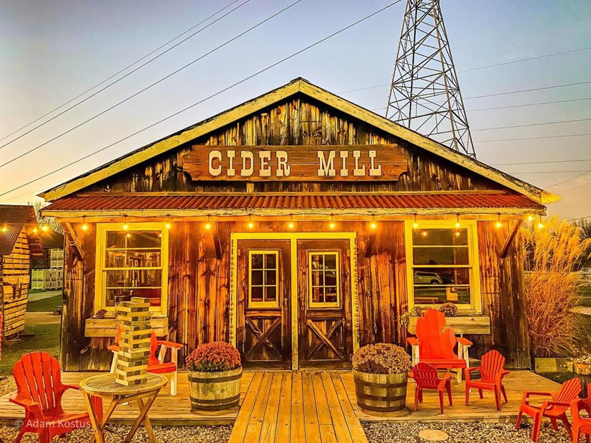 The Cider Mill at Bayne's Apple Valley Farm in Freeland, beautifully lit by string lights as the sun sets