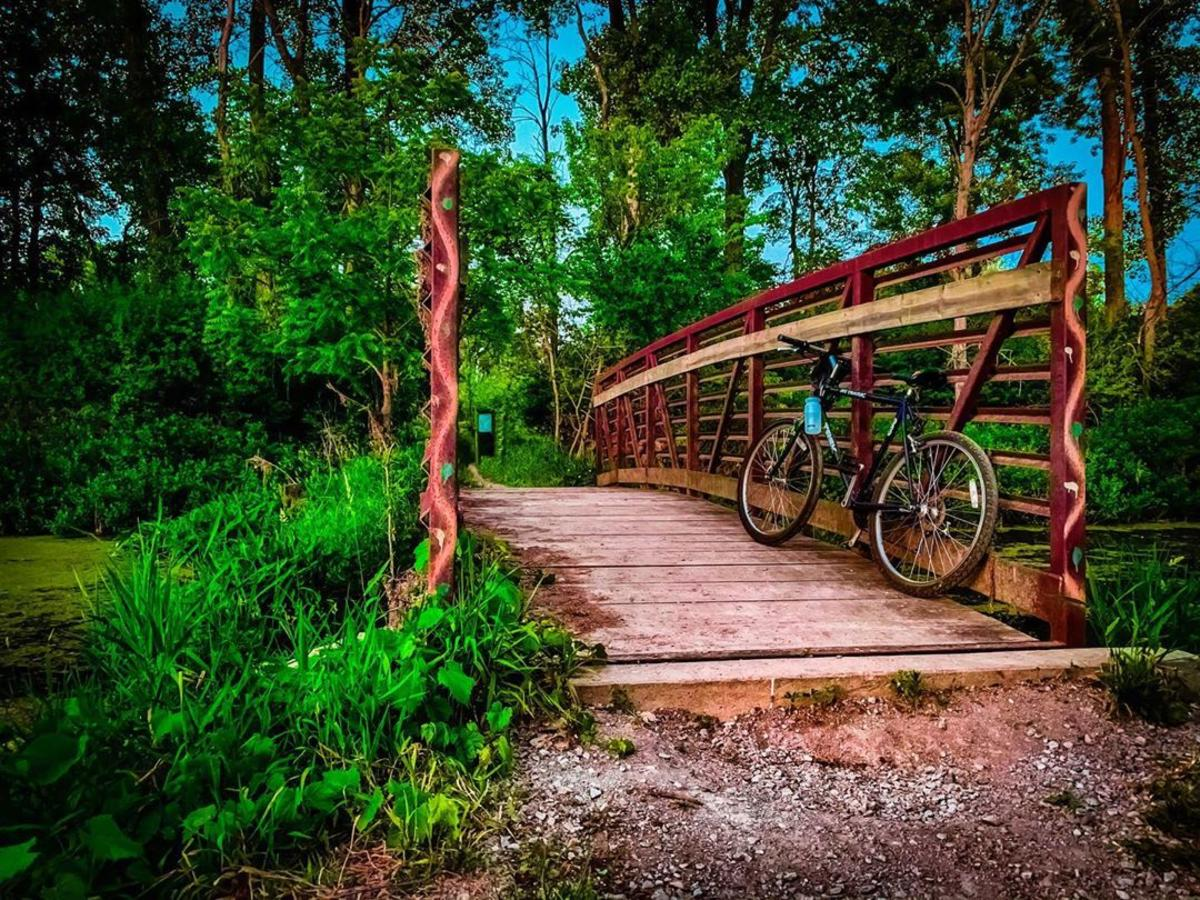 Bike leaning on a bridge over Bullhead Creek on the Woodland Trail within the Shiawassee National Wildlife Refuge in Saginaw