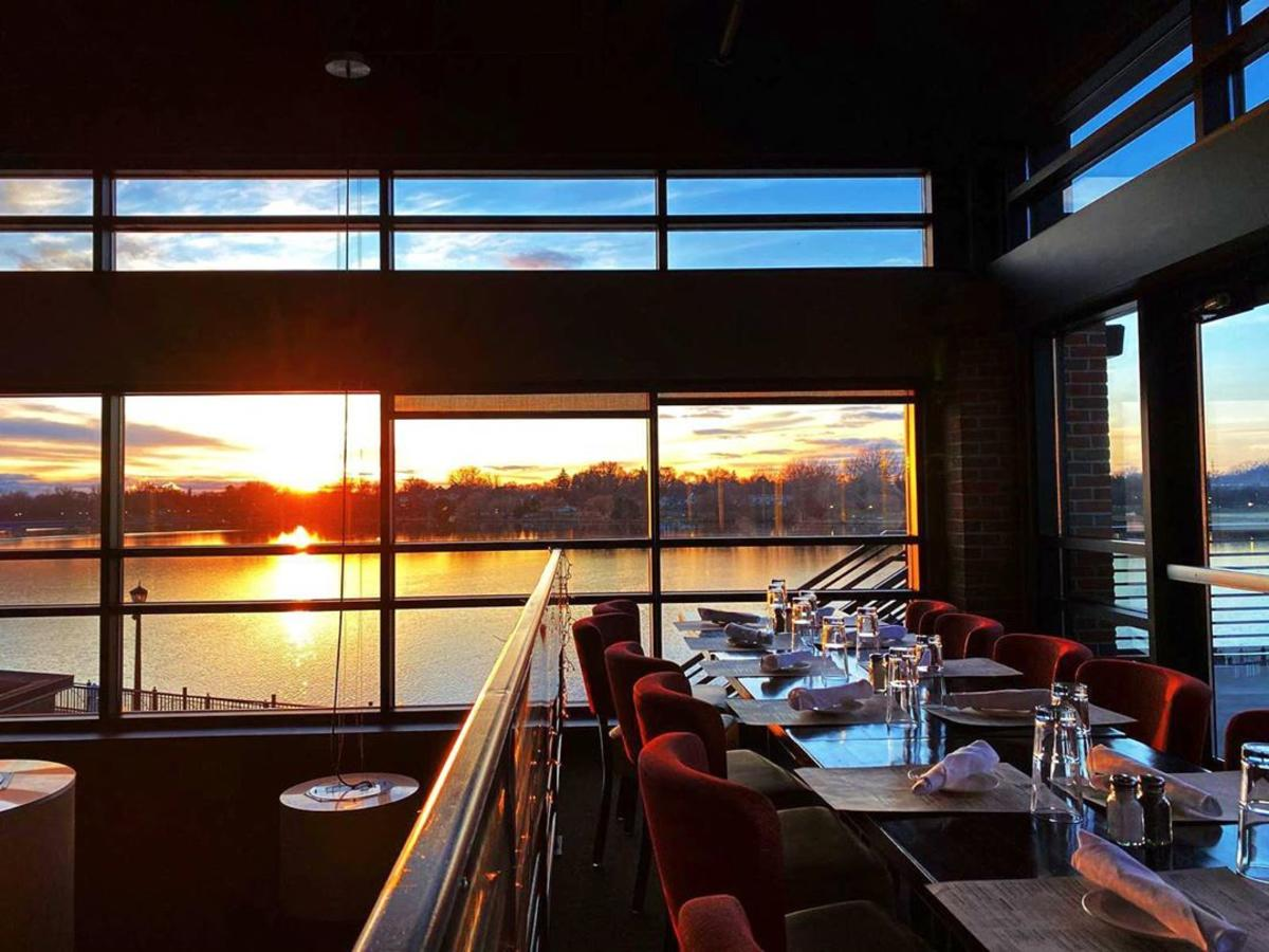Views of the sun setting over the waterfront through a gorgeous wall of windows at Real Seafood Company Bay City