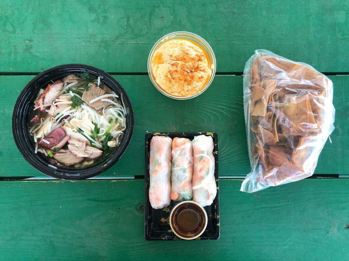 To-go lunch options from SVRC Marketplace in Saginaw, on a colorful picnic table