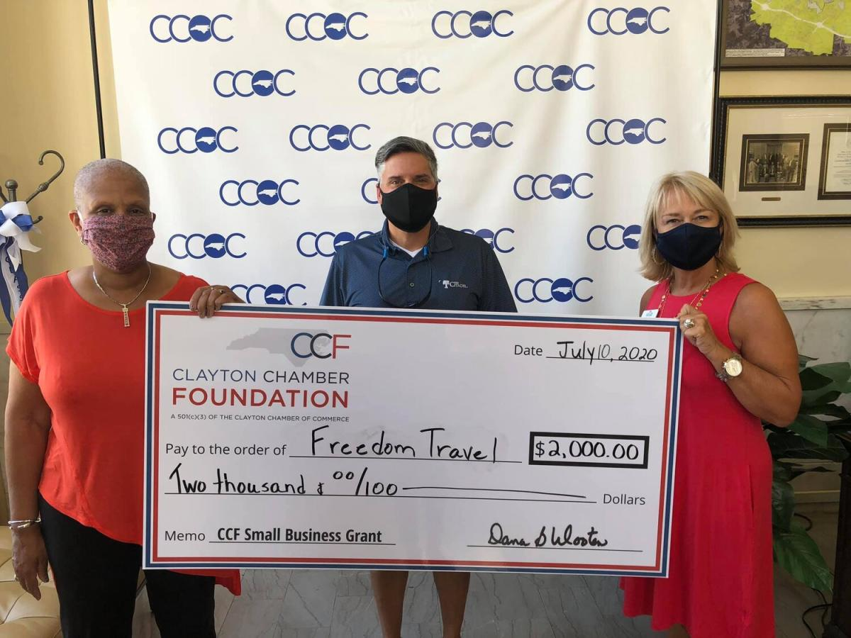 Sharon Wilson of Freedom Travel receiving check for Good Vibes article