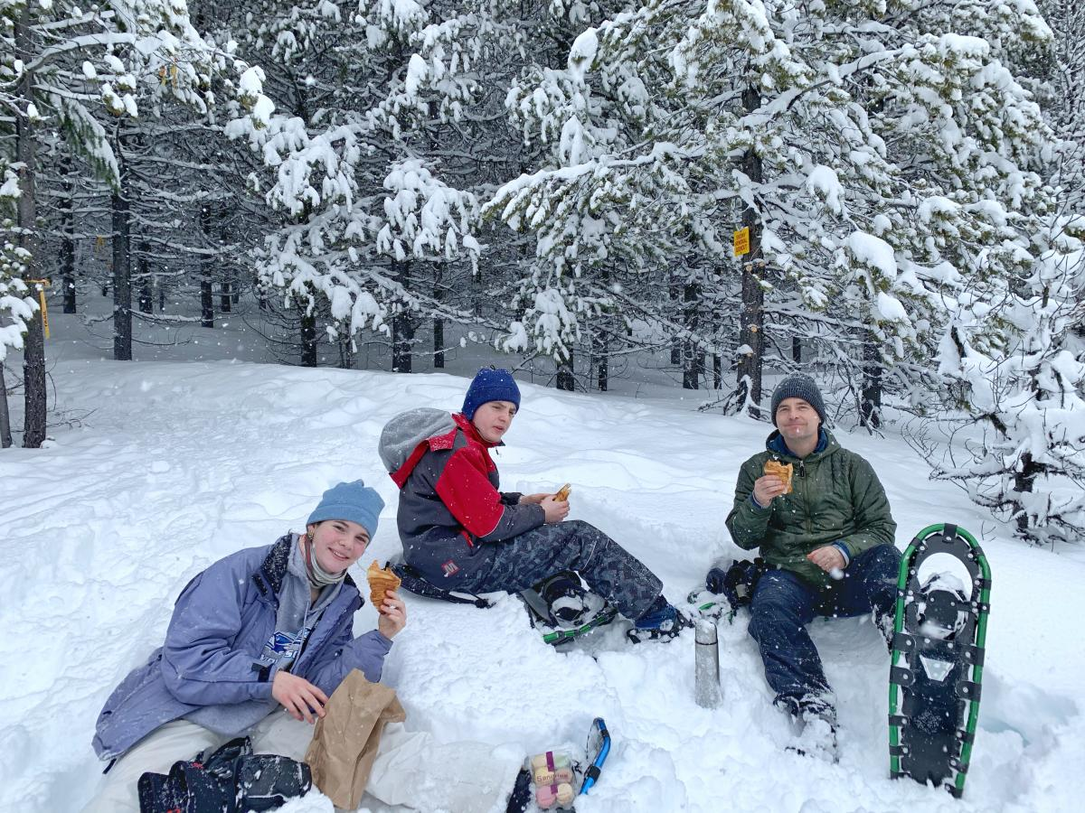 Lisa Kadane's Family Enjoying a Snowshoe Picnic Break