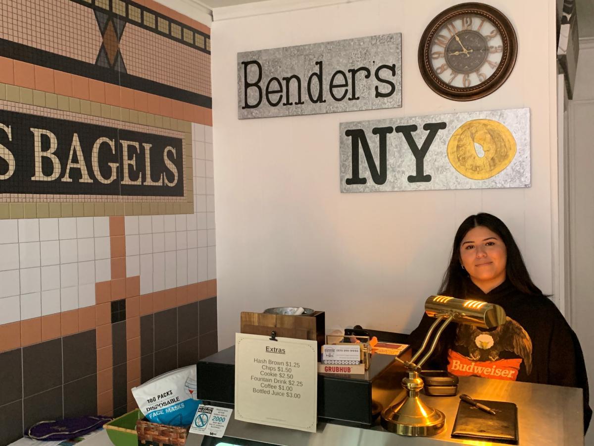 Daji Brun working as a cashier at Bender's NY Bagels in Leesburg, VA