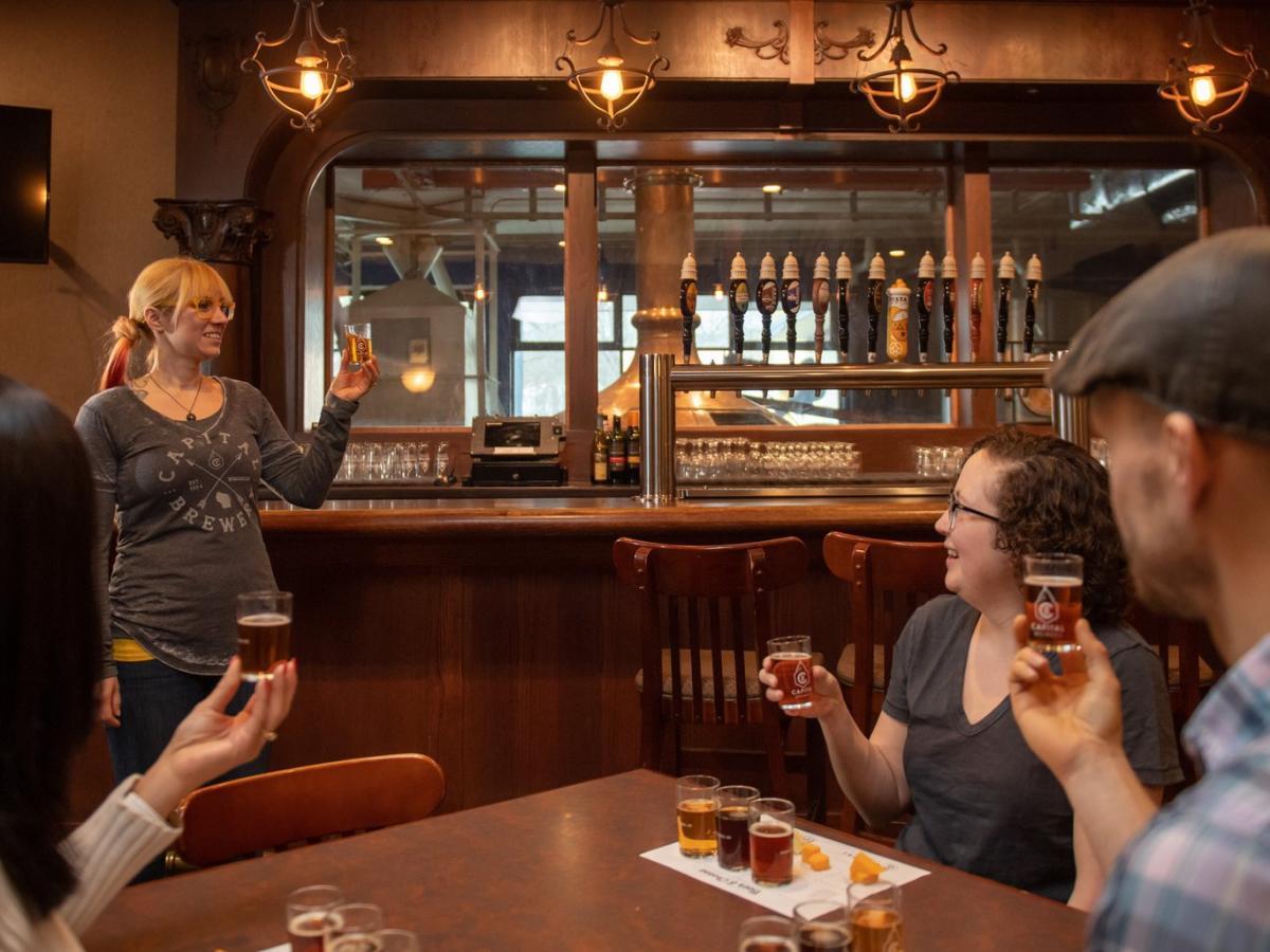 People enjoy having a beer tasting at Capital Brewery