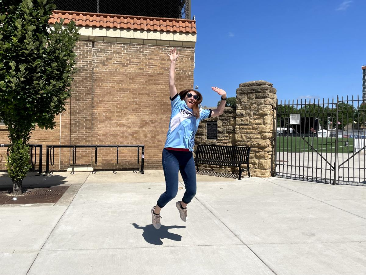 A woman jumps in front of Breese Stevens Field