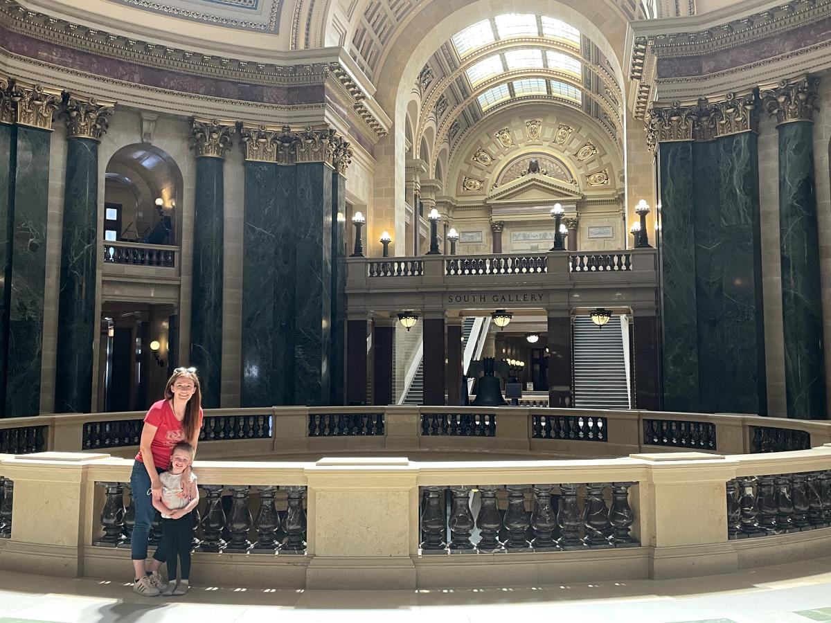 A woman and her daughter pose inside the Wisconsin State Capitol