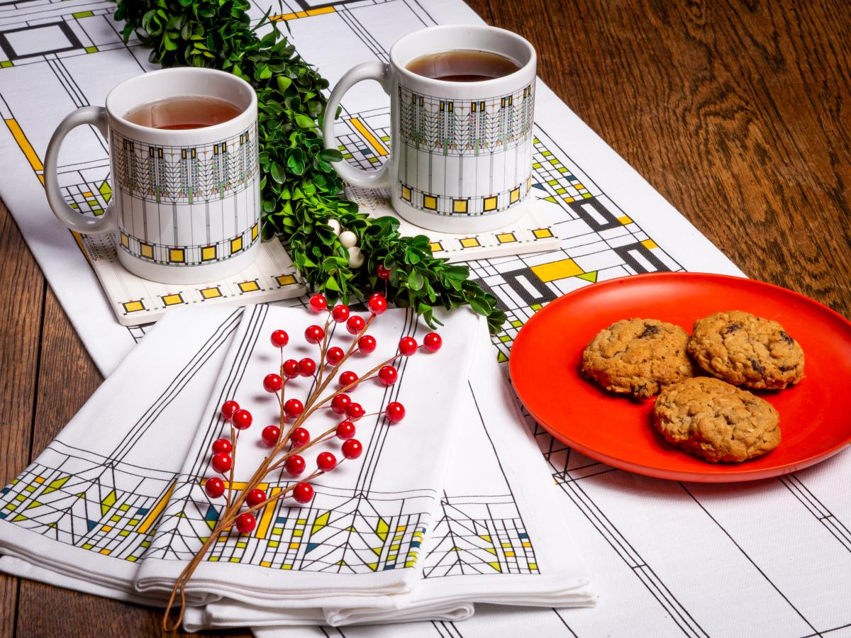 Mugs of coffee and cookies sit out on a decorative table setting courtesy of Taliesin
