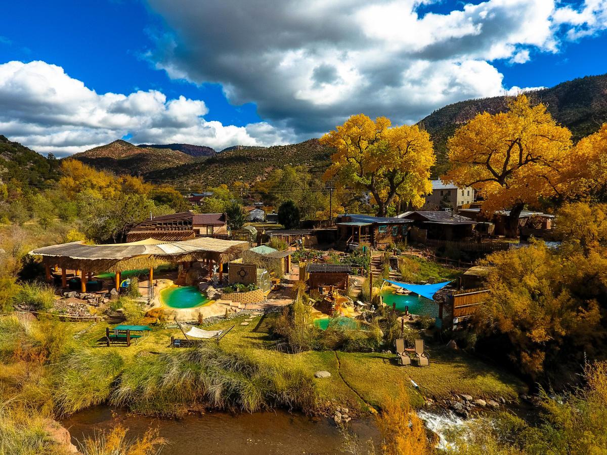 Jemez Hot Springs offers golden leaves against red cliffs.