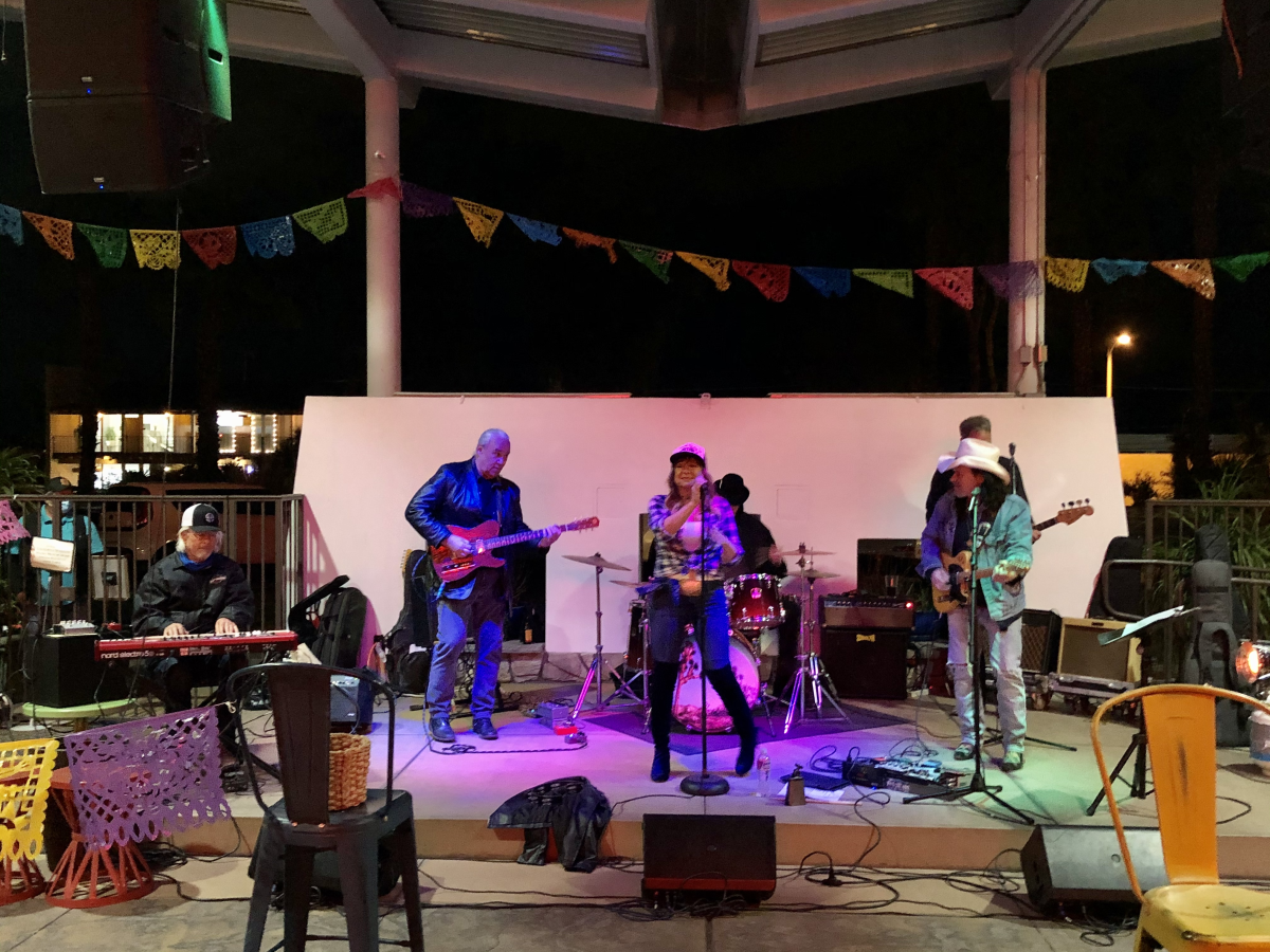 A band performs on the outdoor stage at Casuelas Cafe.