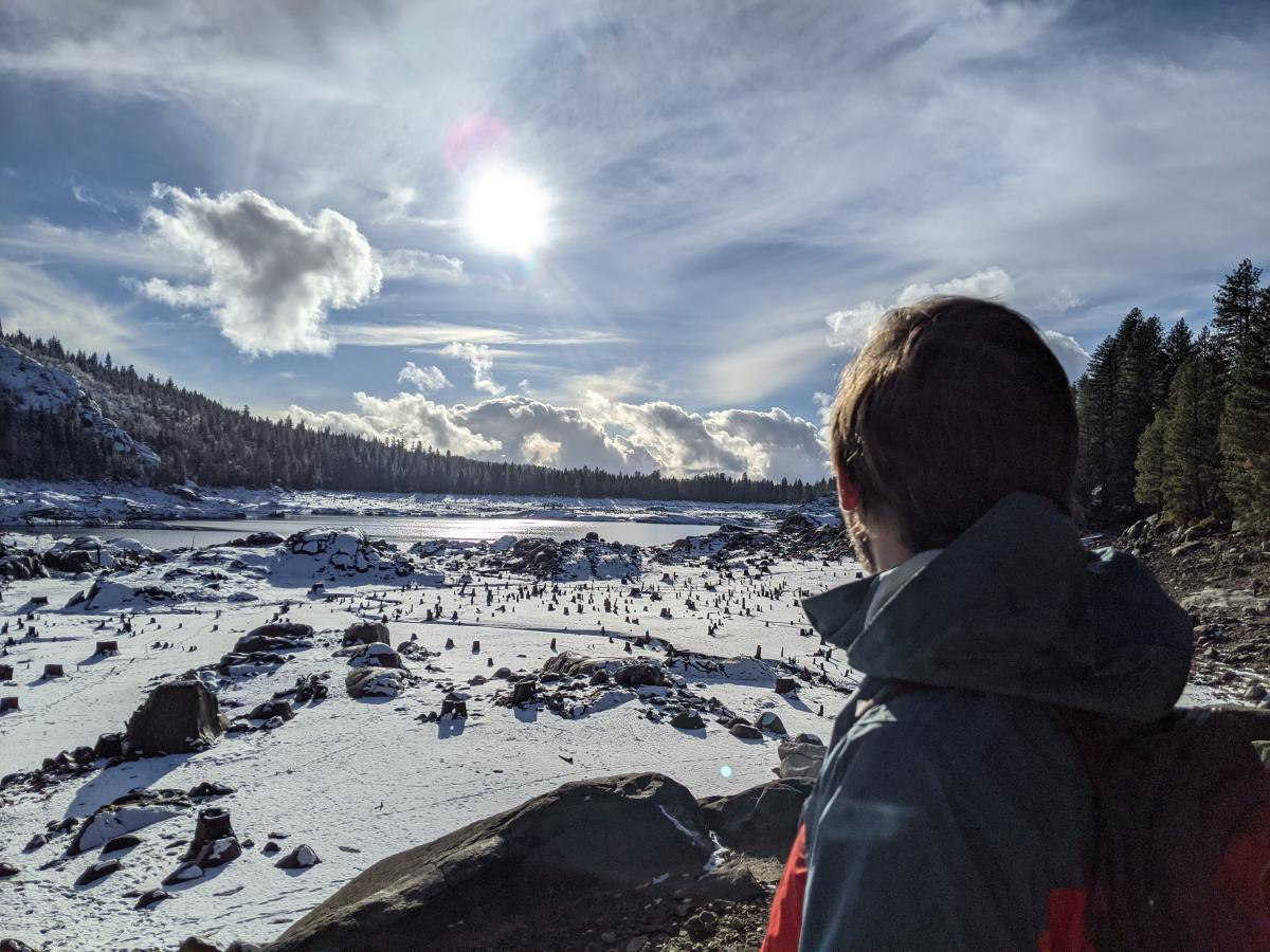back of man's head with frozen lake in the background