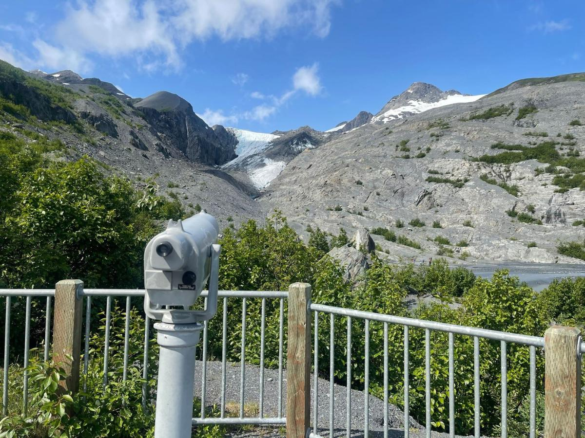 A telescope in a state park focused on an alpine glacier