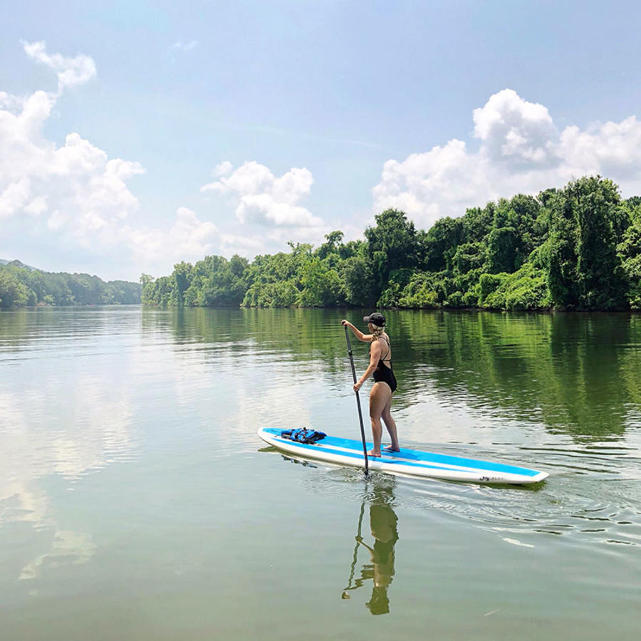 A lone visitor glides along the Huntsville waterways on a stand-up paddleboard.