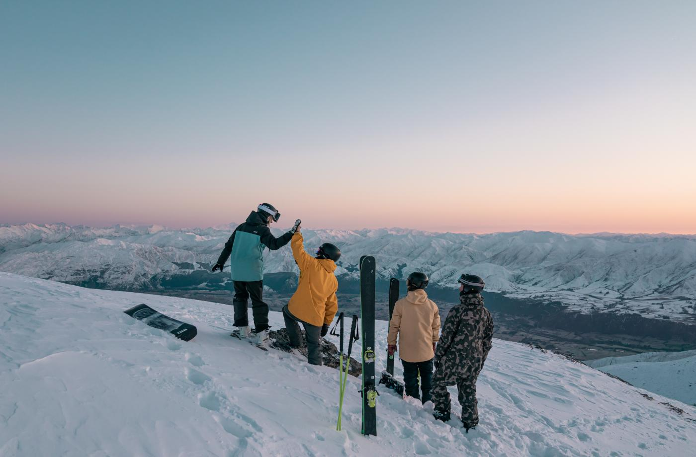Group of skiers and snowboarders at the top of The Remarkables