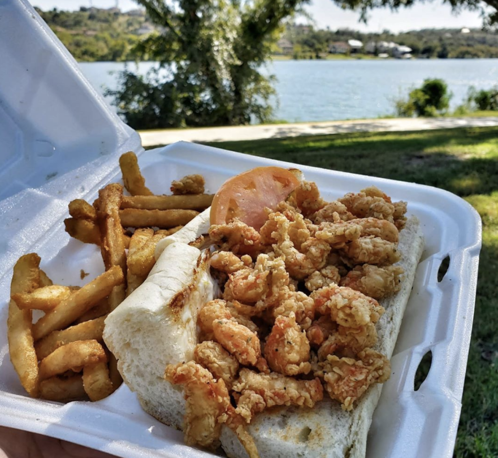 Po Boy and fries in to go container in Marble Falls Texas