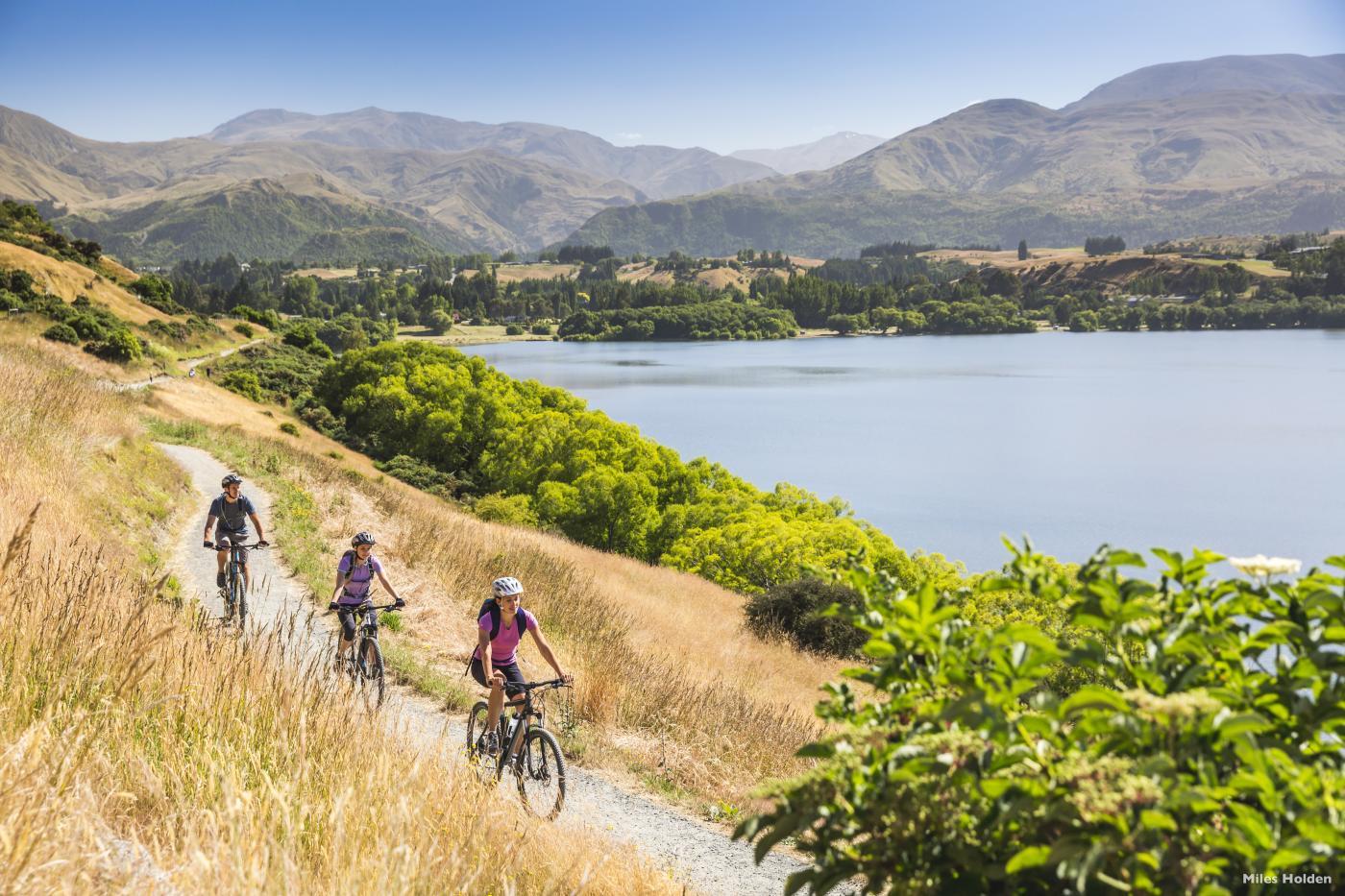 Friends Biking Around Lake Hayes in Summer
